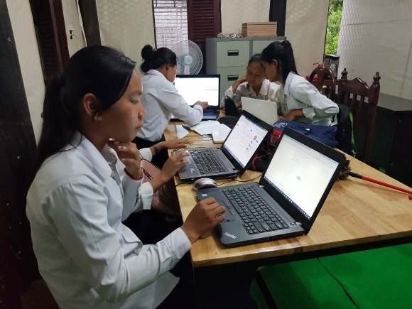 Girls are learning how to create email and send email.